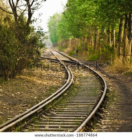Railway or railroad tracks for train transportation - stock photo