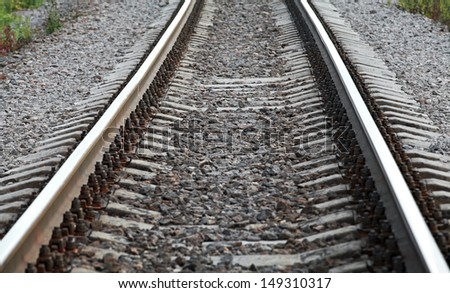Railway perspective with gray gravel on sides