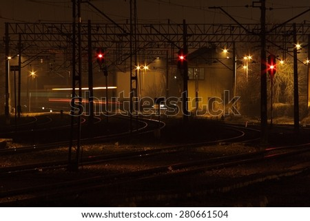 railway platform illuminated at night, building rail, railroad tracks, spotlight  - stock photo