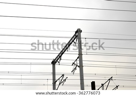 railway poles and electric wires in perspective
