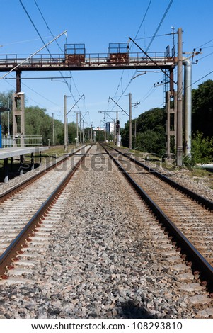 Railway rail road track disappearing over horizont - stock photo