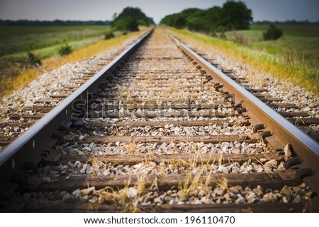 Railway, Railroad, Train Tracks, Green Pasture, Selective Focus - stock photo