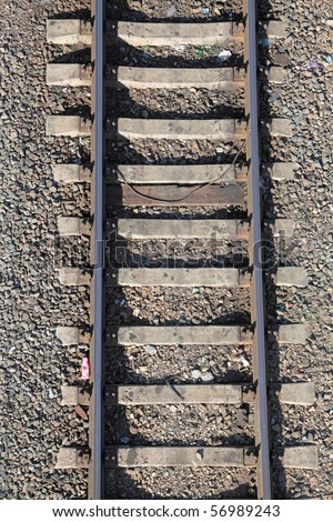 Railway rails on concrete cross ties, a close up, the top view - stock photo