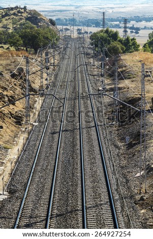 Railway road is alleged in the horizon, vertical  - stock photo