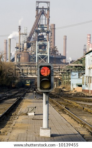 railway signal gantry showing a red light Open the red light for pollution - stock photo