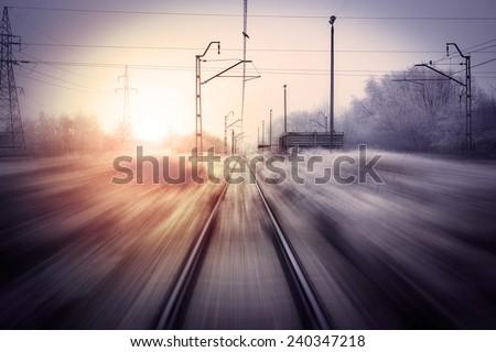 Railway speeding motion blur sunset. - stock photo