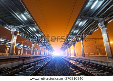 Railway station at night. Train platform in fog. Railroad in Donetsk.  - stock photo