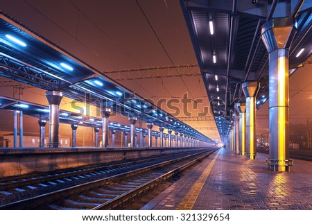 Railway station at night. Train platform in fog. Railroad in Donetsk - stock photo
