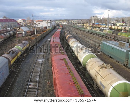 Railway station. Cargo transportation of goods by rail. Train with storage tank - stock photo