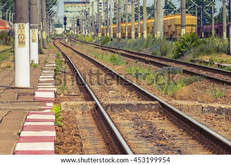 Railway station. Electrified railway track with railway signals - stock photo