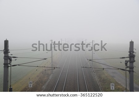 railway system with rails in dense fog - stock photo