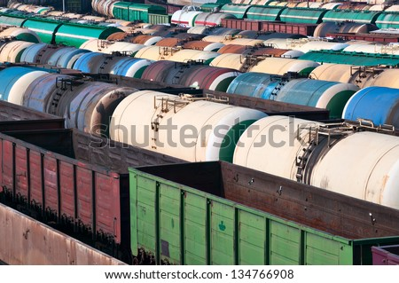 Railway tanks for mineral oil and other cargoes at shunting yard - stock photo