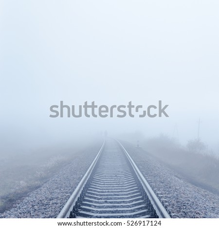 railway to horizon in fog