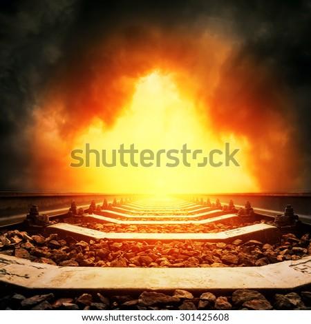 railway to horizon in red dramatic sunset - stock photo