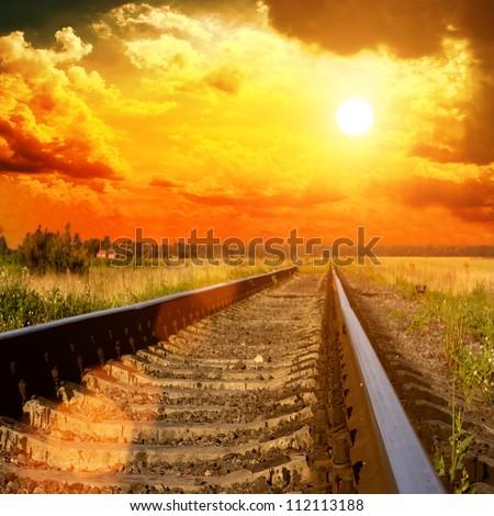Railway to the sunset - stock photo