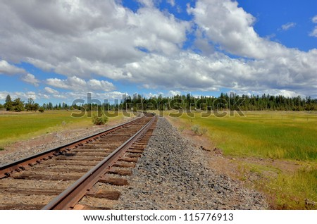 Railway Track and a Cloudy Sky