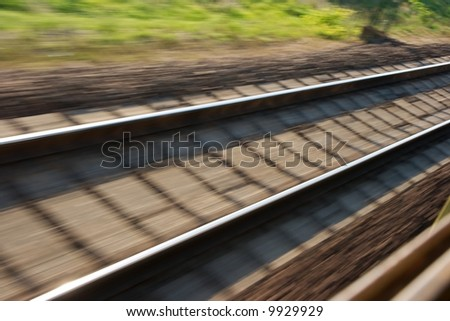 Railway track blurred by high speed motion - stock photo