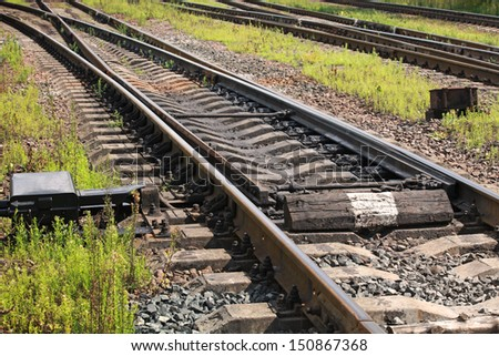 Railway track fragment with switch - stock photo