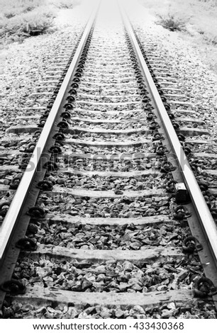 railway track in black and white : concept photo of focus to the goal - stock photo