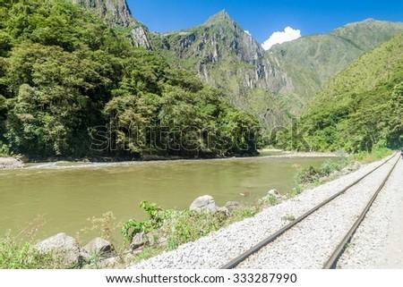 Railway track in Urubamba river valley near Aguas Calientes village, Peru - stock photo