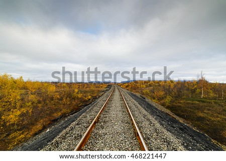Railway track. Late autumn in the Arctic tundra. The northernmost railway in the world. Taimyr Peninsula near Norilsk.