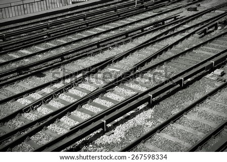Railway tracks - abstract background texture. Transportation network. Black and white tone - retro monochrome style.