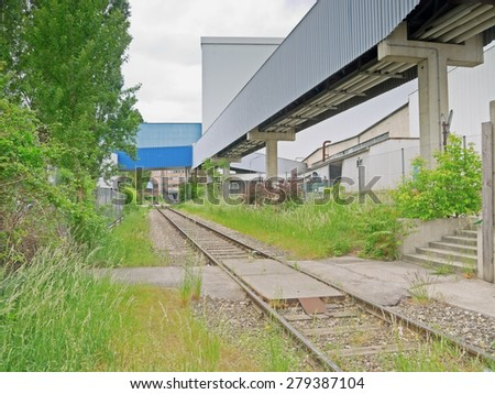 Railway tracks and industrial buildings.  - stock photo