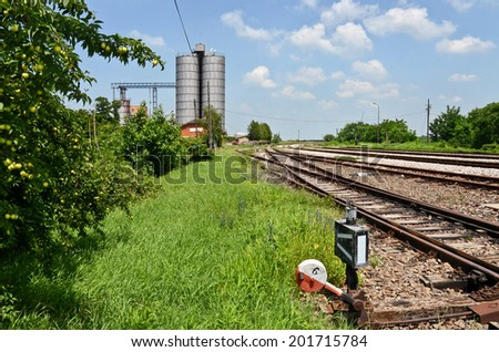 Railway Tracks and Silo - stock photo