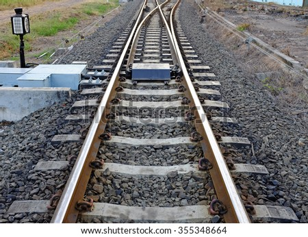 Railway Tracks and Switch near Train Station - stock photo