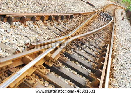 Railway Tracks crossing and going in different directions - stock photo