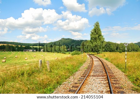 Railway tracks in a beautiful countryside landscape - stock photo
