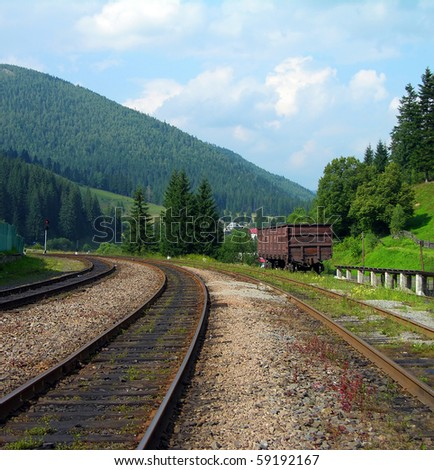 Railway tracks in the mountains - stock photo
