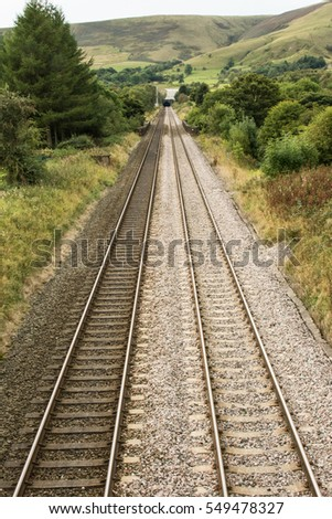 railway tracks into distant tunnel
