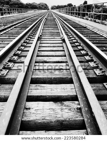 railway tracks on bridge - stock photo