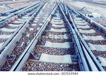 Railway tracks on the big station. - stock photo