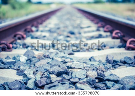 Railway tracks on the station at sunset time - stock photo