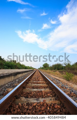 Railway tracks with blue sky and cloud in the evening,Thailand - stock photo
