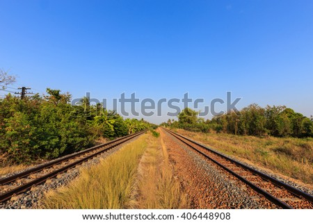 Railway tracks with blue sky  in the evening,Thailand - stock photo