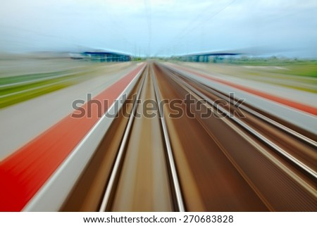 Railway tracks with high speed motion blur - stock photo