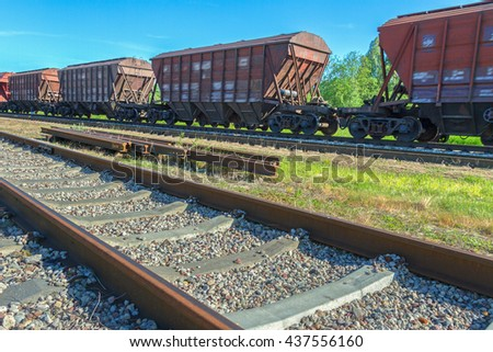 Railway tracks with vacant wagons.