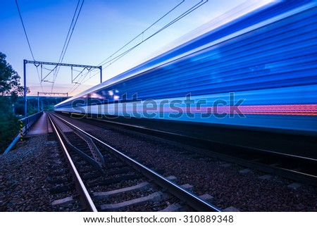 Railway train going over the railway bridge - stock photo