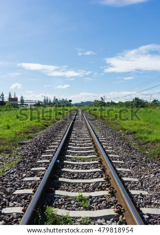 Railway train track lead to desire of the target with blue sky background.