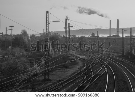Railway. Wires, rails, pipe smokes on the horizon.