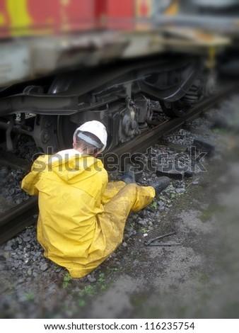 Railway worker replacement brakes - stock photo