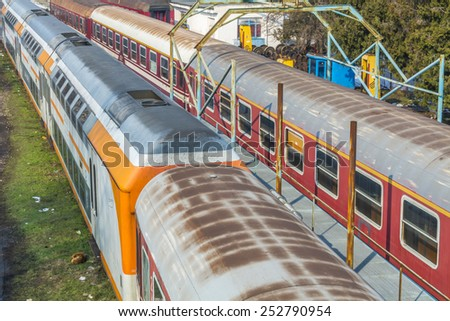 Railways and trains in city train station  - stock photo
