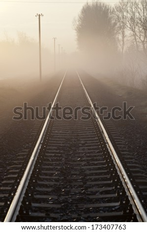 Railways at foggy weather morning