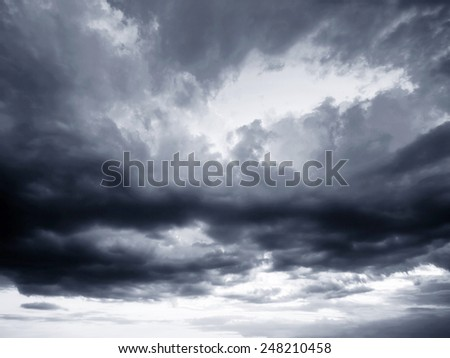 Rain clouds  and gloomy sky in black and white - stock photo
