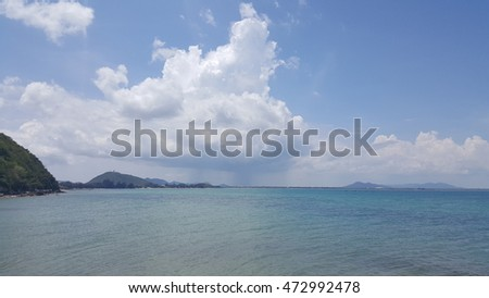Rain Clouds over sea at Sattahip  province, Thailand, blue-shaded sea background