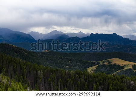 Rain clouds over the mountains - stock photo