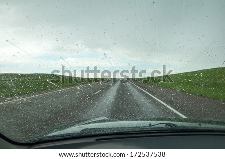 Rain covered windshield - stock photo